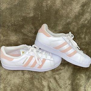 Pink striped Adidas Superstars